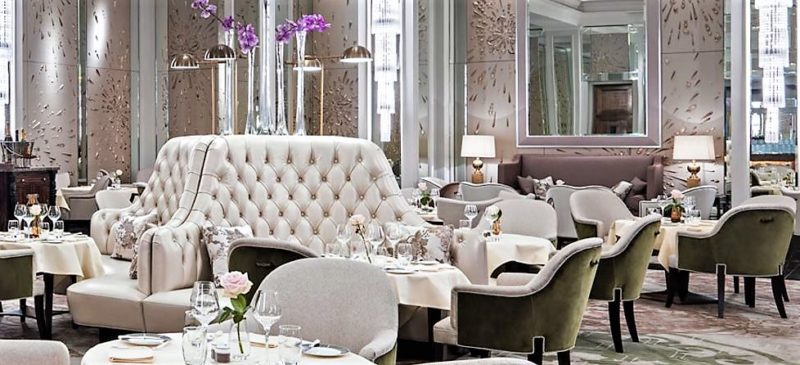 Interior design of the afternoon tea venue, Palm Court at the Langham hotel in London. Timeless elegant style is celebrated with mirrored panelling, upholstered furniture and statement lighting. Click on the link for lots of interior design ideas and a gorgeous product edit. #iba17 #girlabouthouse