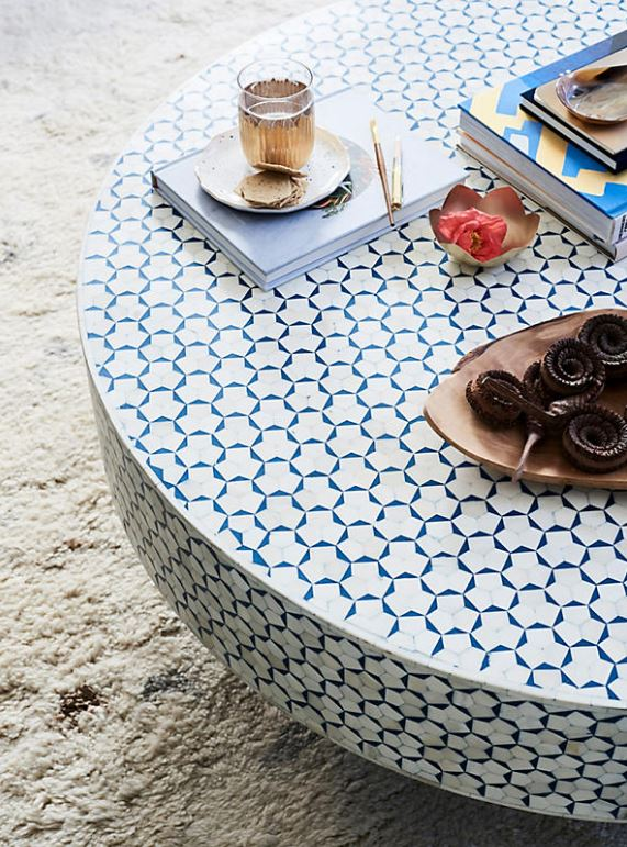 A gorgeous coffee table from Anthropologie. A circular contemporary coffee table is always a great idea with kids!