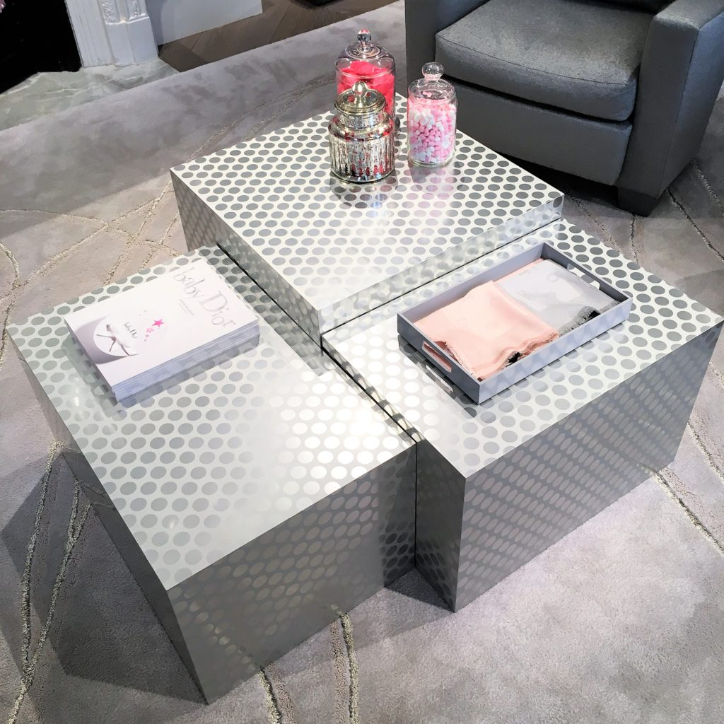 A stylish and contemporary coffee table at Dior's flagship store on Bond Street in London. The eye-catching silver polka-dots make a fabulous statement amongst the neutral grey tones. For more gorgeous coffee tables, click the link...