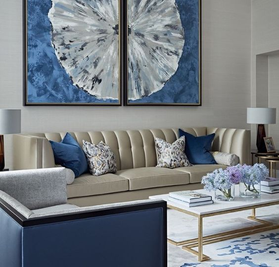 This scheme, designed by Boco Do Lobo, combines neutrals with blue accents. A key interior design secret is to integrate colour with multiple accents, carefully planted around the space to balance the overall scheme. For more ideas and interior design secrets, click on the blog link...