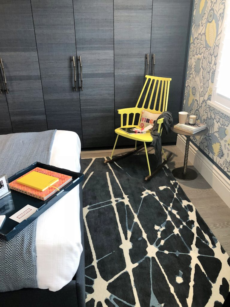 A guest bedroom by Turner Pocock LTD mixed punchy colour - those zingy yellow accents - with print and pattern.