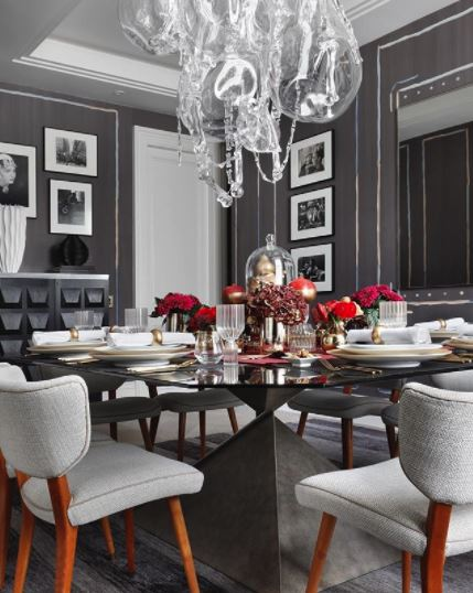 Holiday House London - The dining room opposite, was designed by Rachel Laxer, good friend of Iris Dankner and the talented owner of Rachel Laxer Interiors. A darker vibe within, her focal point was a glamorously-dressed festive table, pairing rich berry shades with striking gold.