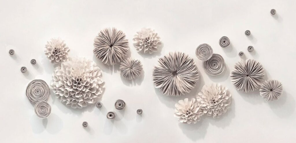 Wall Art: Nascimento's porcelain installations are absolutely stunning. The fluidity, smoothness and delicacy of the porcelain she uses would add depth and interest to any wall space.  Drawing inspiration from the natural world, architectural and botanical forms, Nascimento sees the beauty in repetitive sequencing to form a cohesive and impactful group.